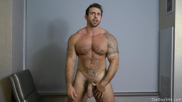 Guy-Site--Muscle-hunk-bear-Xavier-big-muscles-dark-fur-tattooed-stud-masturbates-tattoos-002-male-tube-red-tube-gallery-photo