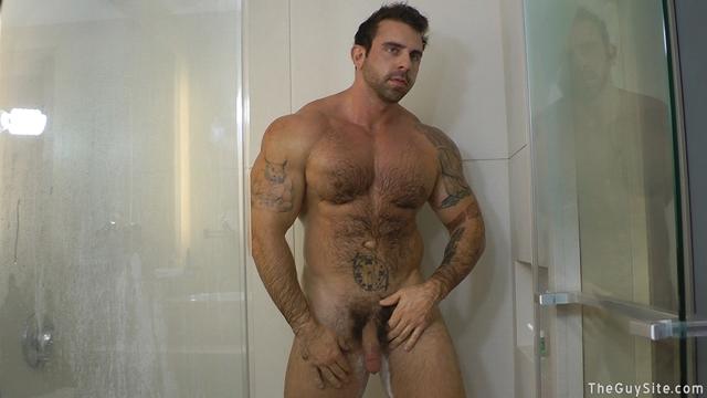 Guy-Site--Muscle-hunk-bear-Xavier-big-muscles-dark-fur-tattooed-stud-masturbates-tattoos-004-male-tube-red-tube-gallery-photo