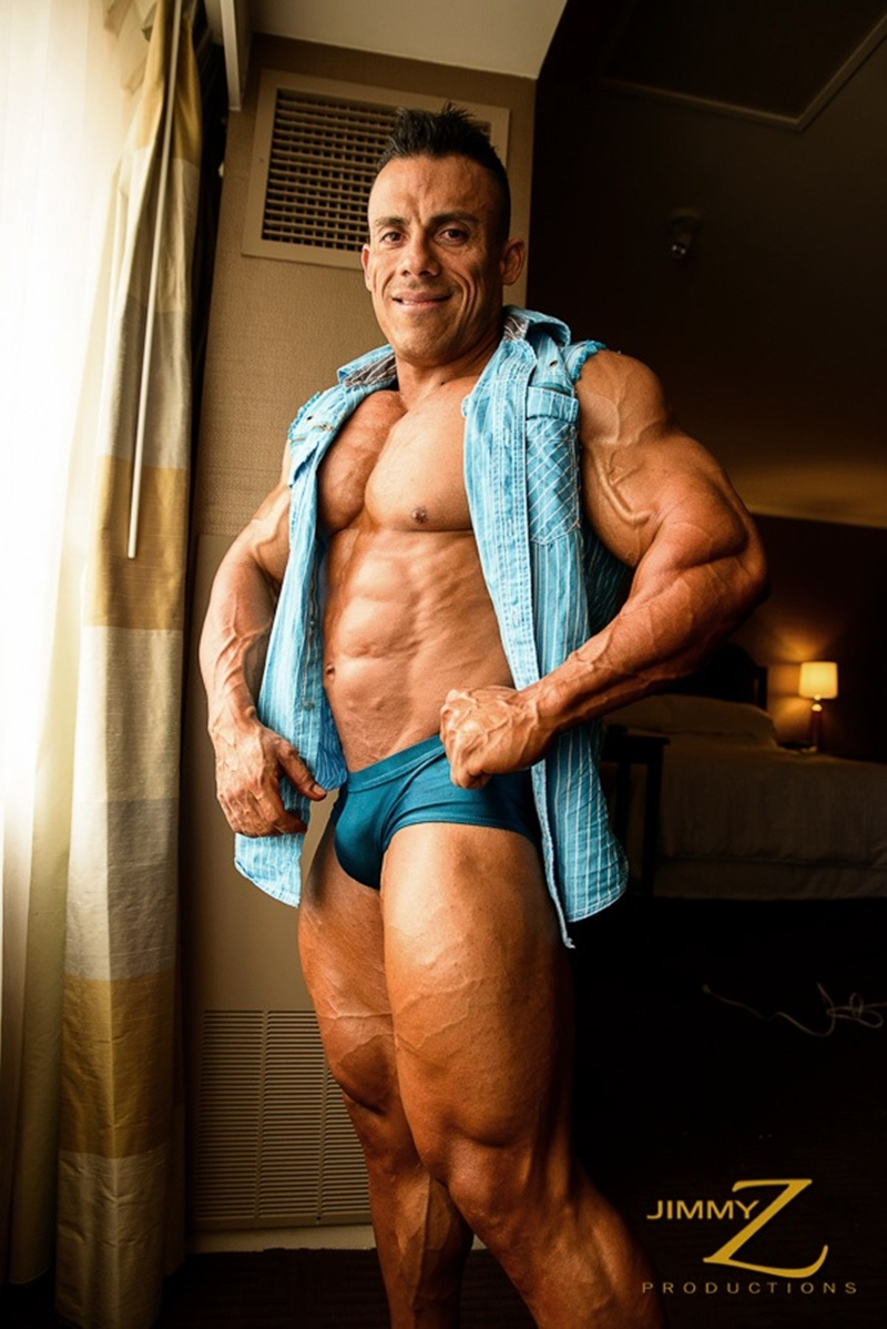 JimmyZProductions-Markus-Ranger-oil-flexes-huge-pecs-huge-biceps-thong-shredded-glutes-world-class-bodybuilder-005-nude-men-tube-redtube-gallery-photo